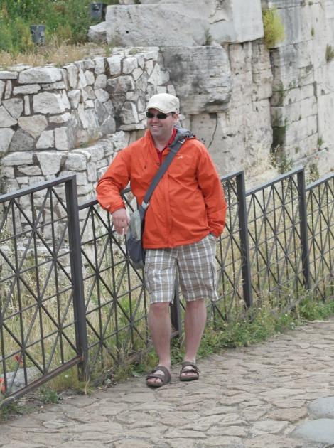 Mr. G. rocking the newboy, Birkenstocks, packable rain jacket, and PacSafe murse